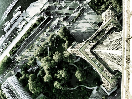 View down to the ground from the highest platform of the Eiffel Tower in Paris.