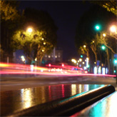Traffic at night in Paris as seen from a bench. The autofocus focused on the bench, instead of the road. Neat effect, in my oppinion.